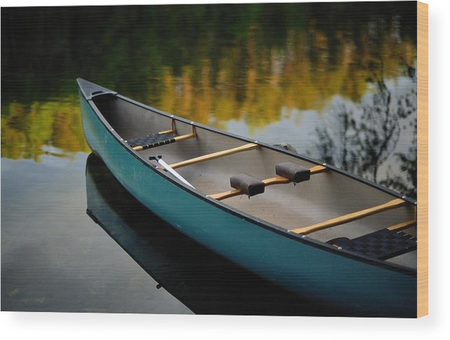 united States Wood Print featuring the photograph Canoe And Reflections On A Still Lake by Raymond Gehman