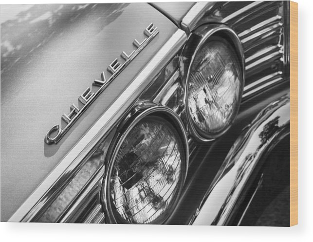 1967 Chevrolet Chevelle Malibu Head Light Emblem Wood Print featuring the photograph 1967 Chevrolet Chevelle Malibu Head Light Emblem by Jill Reger