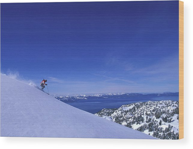 Action Wood Print featuring the photograph One Woman Skiing In Powder High by Corey Rich
