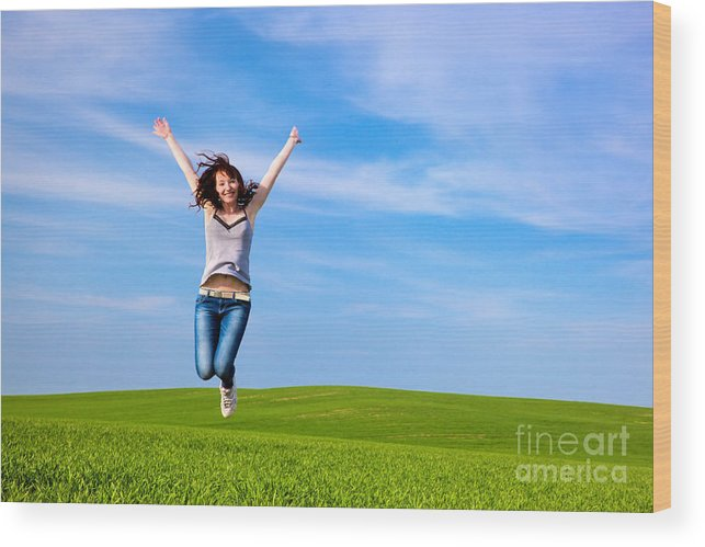 Grass Wood Print featuring the photograph Young Beautiful Woman Jumping For Joy by Michal Bednarek