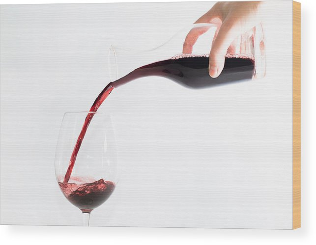 Glass Wood Print featuring the photograph Red Wine Pouring Into A Glass by Frank Gaertner