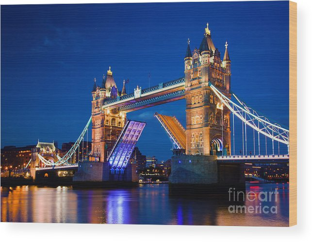 Tower Wood Print featuring the photograph Tower Bridge In London Uk At Night by Michal Bednarek