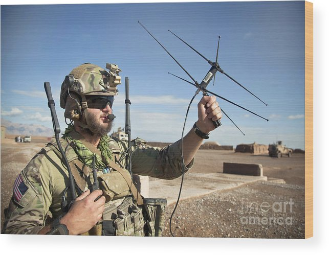 Afghanistan Wood Print featuring the photograph A Coalition Force Member Maintains by Stocktrek Images