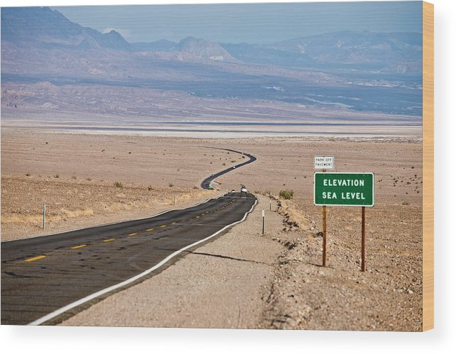 Arid Wood Print featuring the photograph A Long Road Through Death Valley by Rob Hammer