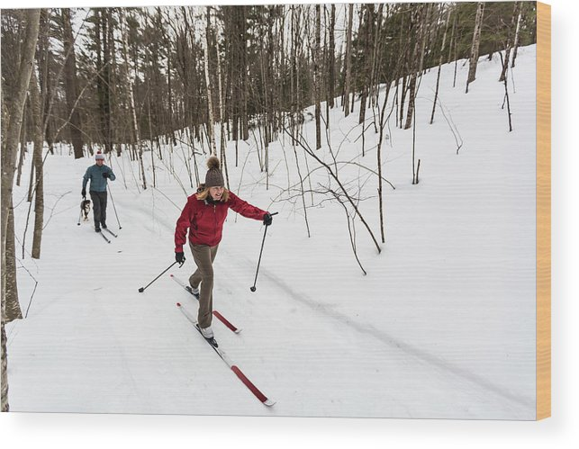 On The Move Wood Print featuring the photograph A Man And Woman Cross Country Skiing by Jerry Monkman