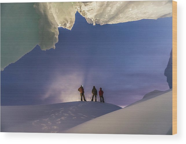 Adult Wood Print featuring the photograph A Man Stands At The Entrance Of An Ice by Alasdair Turner