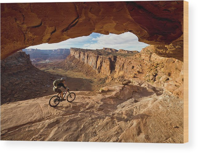 Activity Wood Print featuring the photograph A Mountain Biker Rides By On Slickrock by Whit Richardson
