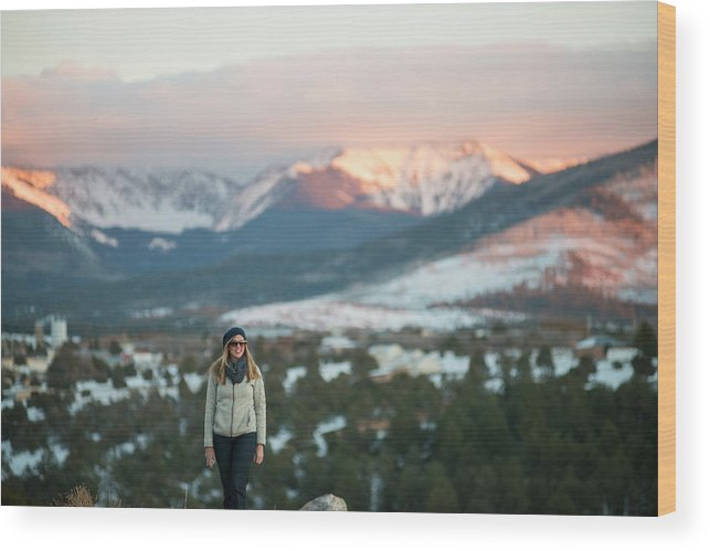 30-34 Years Wood Print featuring the photograph A Woman Stands Against A Snowy Mountain by David Zentz