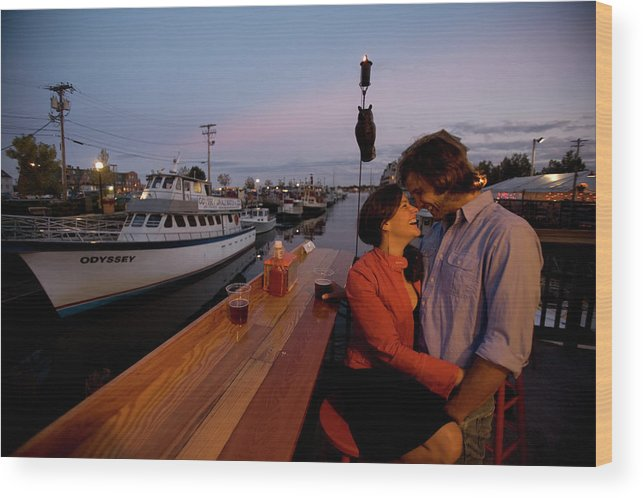 20s Wood Print featuring the photograph A Young Couple Embraces On The Deck by Jose Azel