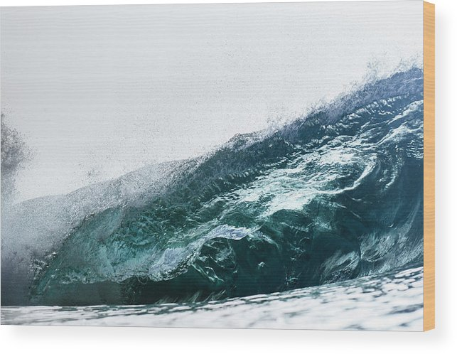 Wave Wood Print featuring the photograph An Empty Wave Breaks Over A Shallow Reef by Sergio Villalba