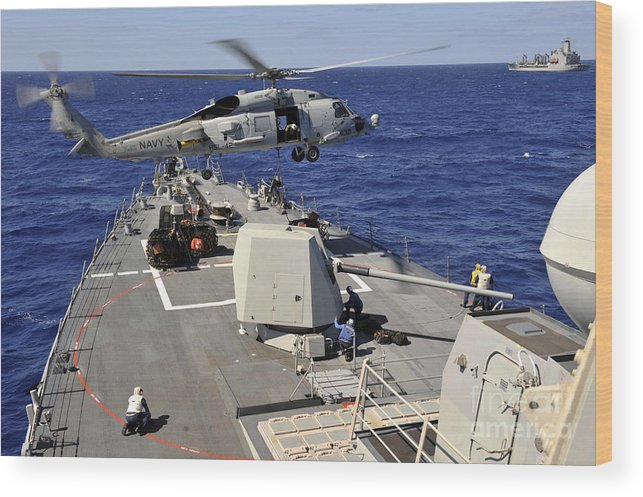 Vertical Replenishment Wood Print featuring the photograph An Sh-60b Sea Hawk Helicopter Picks by Stocktrek Images