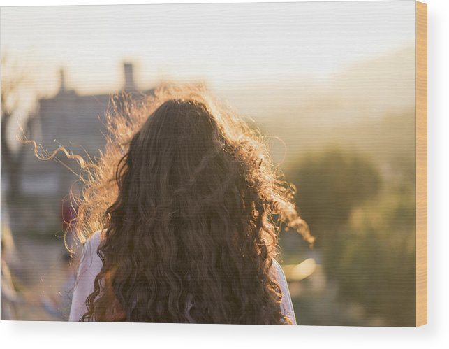 Back View Of Young Woman With Long Curly Hair At Sunset Wood Print