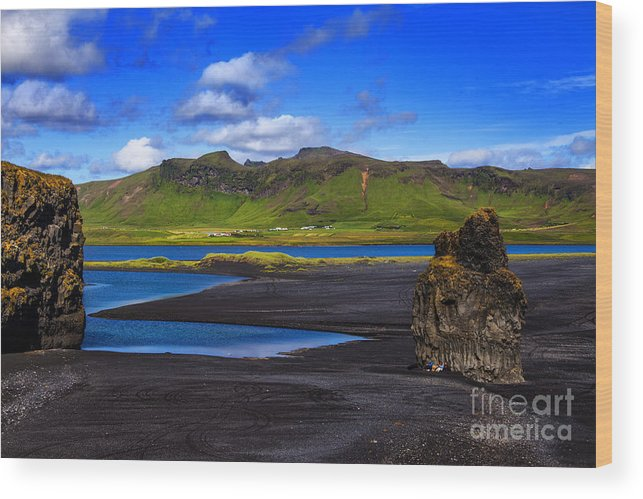 Iceland Volcano Black Beaches Wood Print featuring the photograph Beyond The Rocks by Rick Bragan