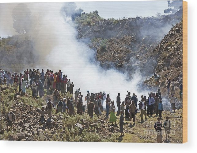 Human Wood Print featuring the photograph Burning Contraband Goods, Ethiopia by Brian Gadsby