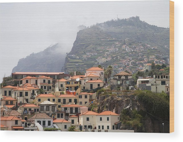 Horizontal Mist Misty Cable Car Outdoor Tourist Tours View Spectacular Vacation Holiday Atlantic Ocean Portuguese Sea Cliff Steep Escarpment Look Out Point Panoramic Coast Coastline Waves Exterior Landscape Mountains Rocks Mountainous Calm Water Summer Seashore Color Color Daytime Outdoor Nobody Houses Red Roofs Village Hillside Slope Wood Print featuring the photograph Cabo Girao Madeira Portugal by Jim Wallace