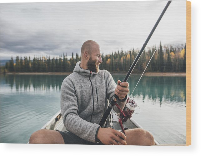 Canada British Columbia Man Fishing In Canoe On Boya Lake Wood