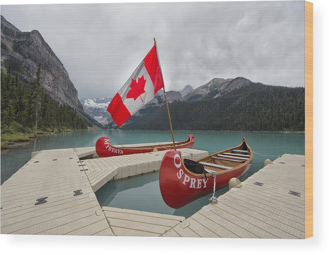 Lake Wood Print featuring the photograph Canoes And Canada Flag At Lake Louise by Jack Nevitt