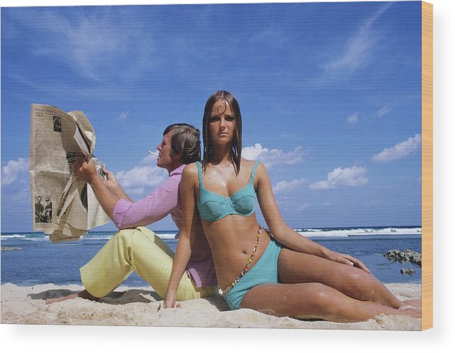 Accessories Wood Print featuring the photograph Cheryl Tiegs Modeling A Bikini At A Beach by William Connors