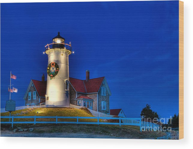 Lighthouse Wood Print featuring the photograph Christmas By The Sea by Michael Petrizzo