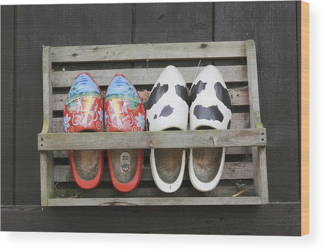 Clogs Wood Print featuring the photograph Clogs In A Rack by Ronald Jansen