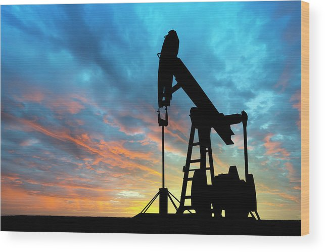 Shadow Wood Print featuring the photograph Dawn Over Petroleum Pump by Grafissimo