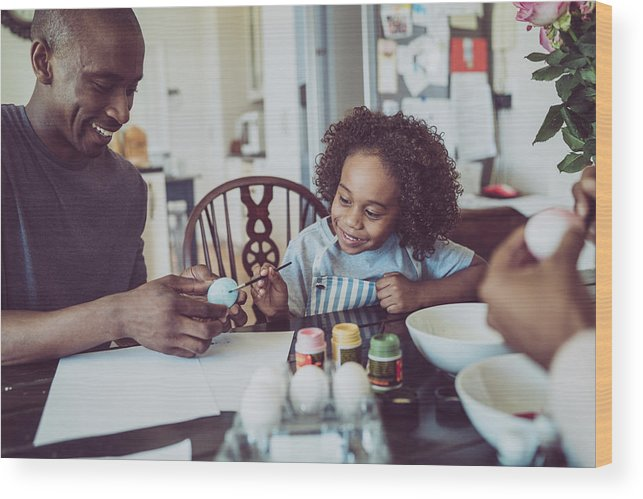 Young Men Wood Print featuring the photograph Father And Boy Colouring Easter Egg Together by Portra