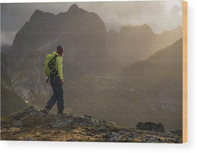 Tverrfjellet Wood Print featuring the photograph Female Hiker On Summit Of Tverrfjellet by Cody Duncan