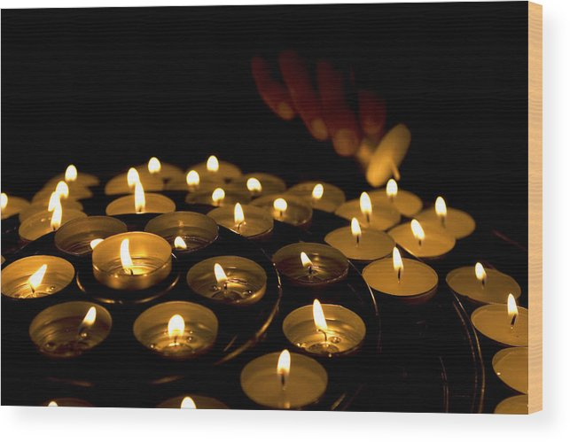 Close Up Wood Print featuring the photograph Hand Lighting Candles by Fabrizio Troiani