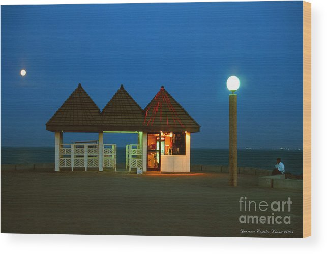 Pier Wood Print featuring the photograph Kuwaiti Pier Snack Bar At Dusk by Lawrence Costales