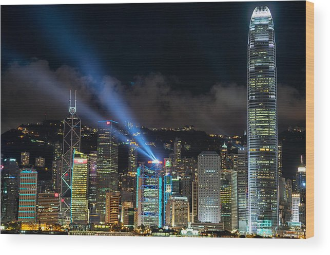 Laser Show Wood Print featuring the photograph Laser Show In Hk by Thierry CHRIN