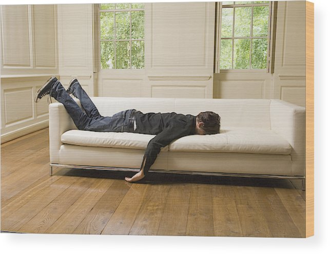 Man Lying Face Down On Sofa In Living Room Wood Print