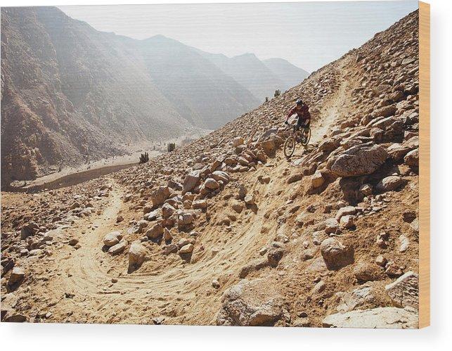 Adventure Wood Print featuring the photograph Mountain Biker Rides Through Rocky by Dan Barham