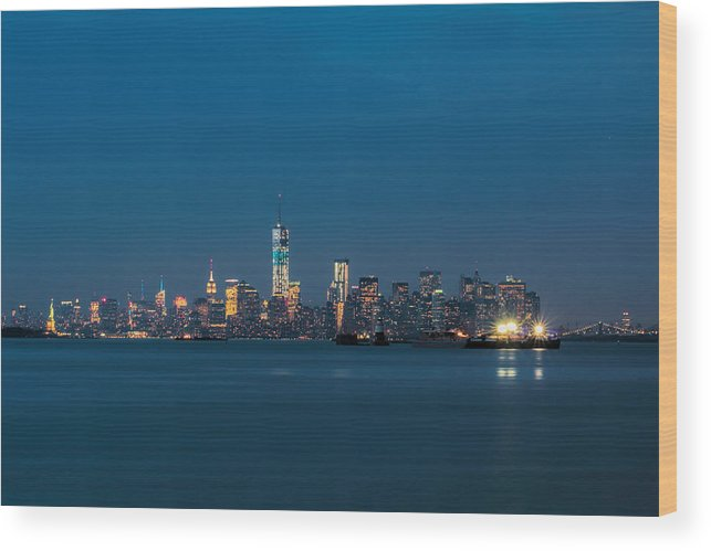 New York City Wood Print featuring the photograph New York Twilight by Jonathan Davison