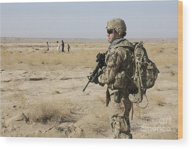Afghanistan Wood Print featuring the photograph Petty Officer Maintains Security by Stocktrek Images