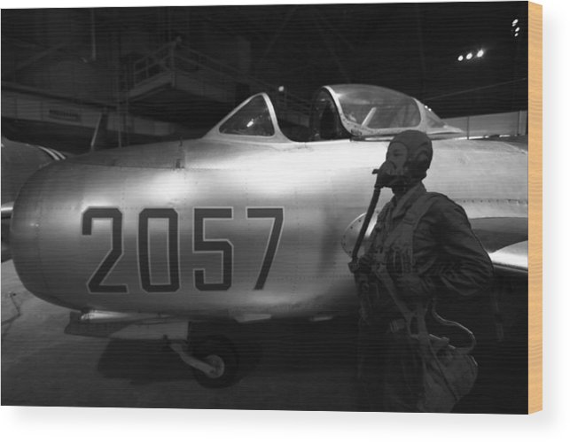 Pilot And His Airplane In The Hangar Wood Print featuring the photograph Pilot And His Airplane In The Hangar by Dan Sproul
