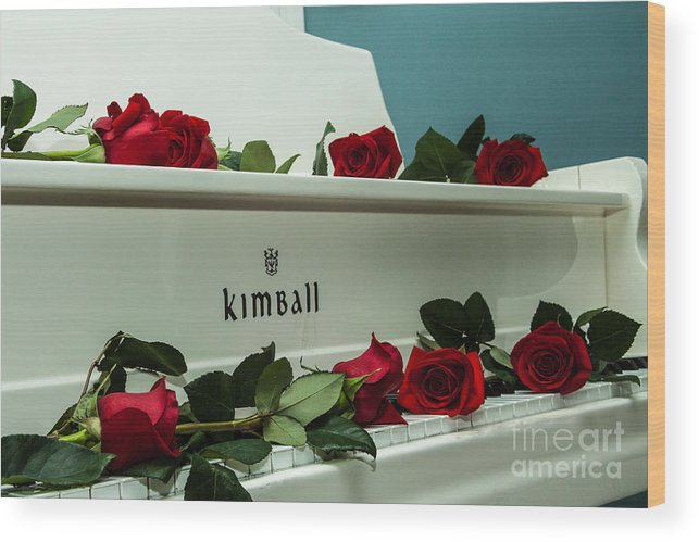 Red Rose Blooms On A White Grand Piano Photograph Wood Print featuring the photograph Red Roses On The Grand Piano by Terri Morris
