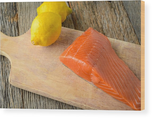 Sea Wood Print featuring the photograph Salmon With Lemons On Wood Background by Brandon Bourdages