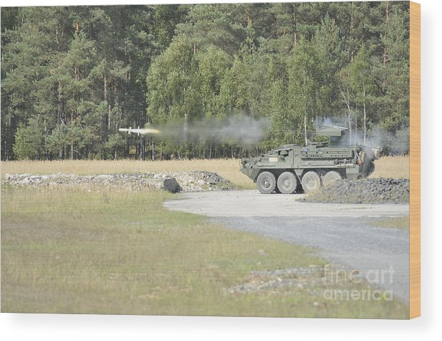 Tow Missiles Wood Print featuring the photograph Soldiers Fire A Tow Missile by Stocktrek Images