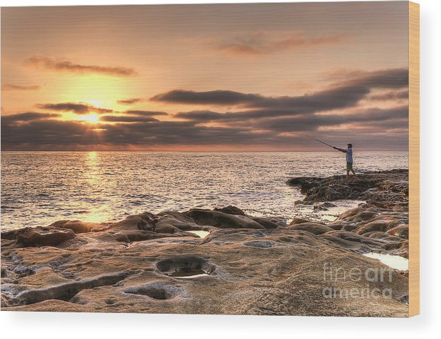 Sunset Wood Print featuring the photograph Sunset Fisherman by Eddie Yerkish