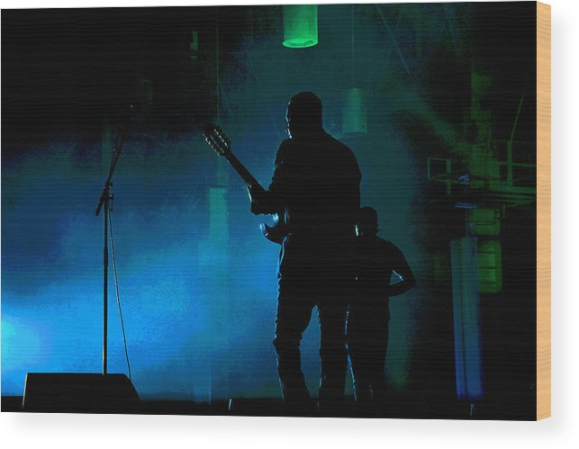 Guitarist Wood Print featuring the photograph The Guitarist by Mike Flynn