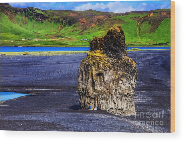 Iceland The Black Volcanic Beaches Wood Print featuring the photograph The Rock People by Rick Bragan