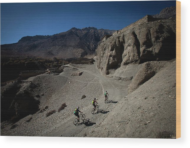 25-29 Years Wood Print featuring the photograph Three Men Seen From Above Ride Mountain by Trevor Clark