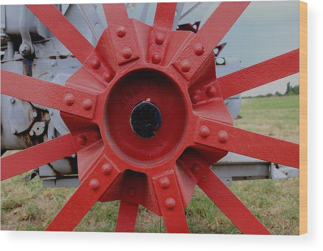 Starburst Wood Print featuring the photograph Tractor Hub by Trent Mallett