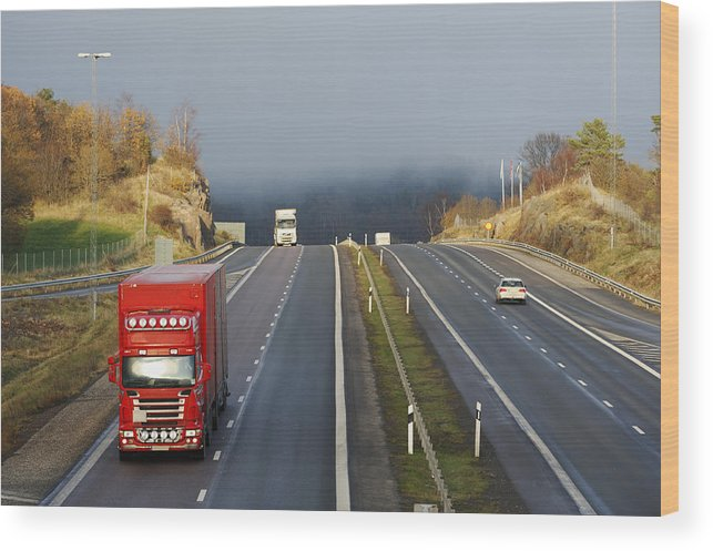 Truck Wood Print featuring the photograph Trucks Driving Through A Misty Mountain Pass by Christian Lagereek