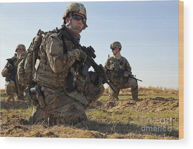 Afghanistan Wood Print featuring the photograph U.s. Navy Petty Officer Takes A Break by Stocktrek Images