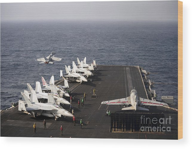 Military Wood Print featuring the photograph Uss Enterprise Conducts Flight by Stocktrek Images