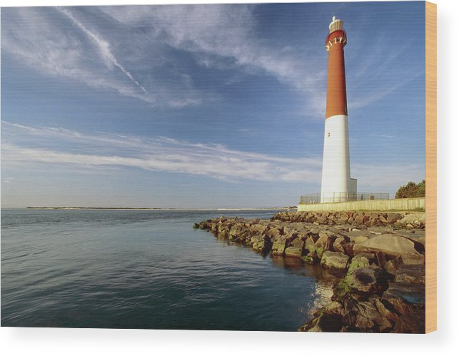 Architecture Wood Print featuring the photograph View Of A Red And White Lighthouse by George Oze