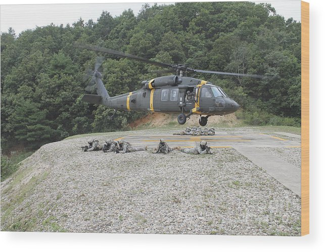Military Wood Print featuring the photograph Wolfhounds Air Assault From A Uh-60 by Stocktrek Images