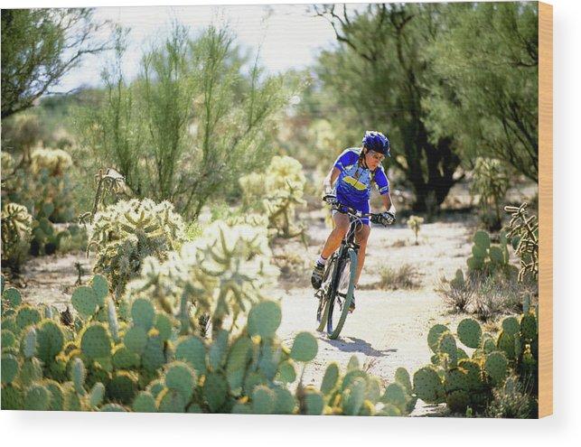 Action Wood Print featuring the photograph Woman Mountain Biking In Arizona by Scott Markewitz