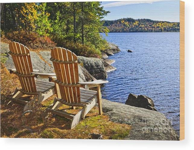 Chairs Wood Print featuring the photograph Adirondack Chairs At Lake Shore by Elena Elisseeva